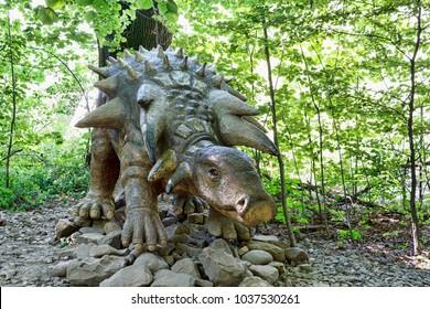 Big model of prehistoric dinosaur Edmontonia in nature. Realistic scenery.