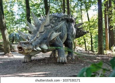 Big model of prehistoric dinosaur like stegosaurus in nature. Realistic scenery.