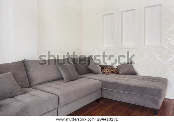 Big modern corner couch in a living room