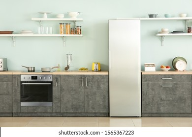 Big modern fridge in interior of kitchen