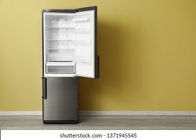 Big modern fridge near color wall