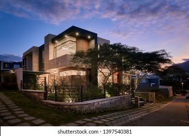 Big modern house exterior at night