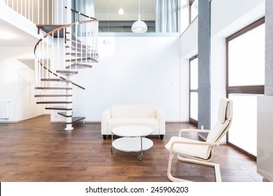 Big modern main room with coffee table and chairs