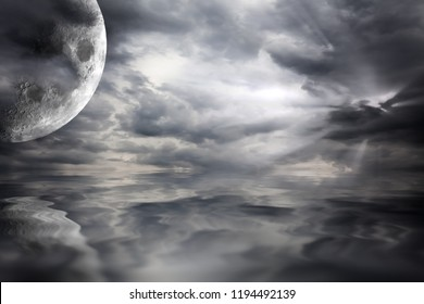 Big moon over water scifi landscape with storm clouds. Black and white fantasy waterscape with reflections of the planet in the sea