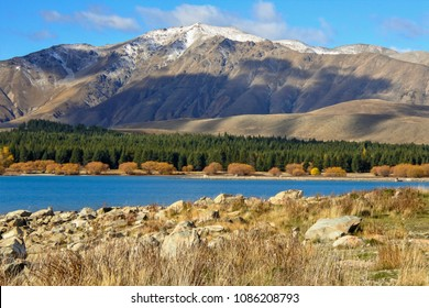 The big mountain behind Lake Tekapo on the sunny day, New Zealand.