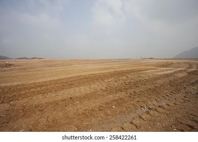 big mud platform with blue sky
