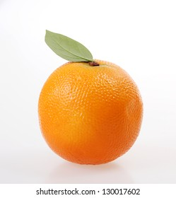 big and natural orange with a leaf over white background