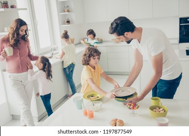 Big nice beautiful cheerful foster joyful caucasian family, six people, doing housework, dishes, cleaning, mom drinking cacao, son helping daddy, white light interior dining room, preteen