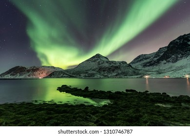 Big northern lights (Aurora borealis) over Grotfjord, Arctic Norway