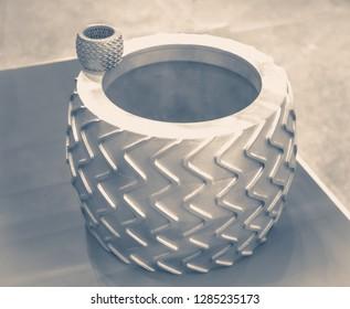 Big object printed on metal 3d printer. A model created in a laser sintering machine close-up. DMLS, SLM, SLS technology. Concept of 4.0 industrial revolution. Progressive modern additive technology.