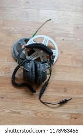 Big old headphones on top of tape rolls