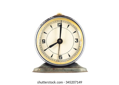 Big old vintage alarm clock isolated on white background