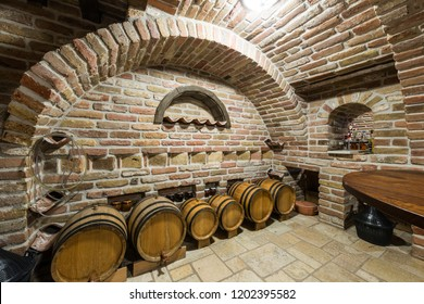 Big and old wine cellar with many full bottles