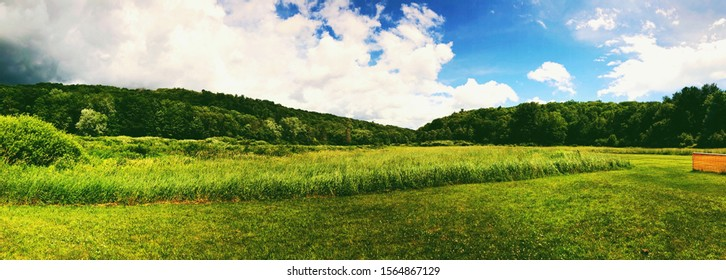 A big open field inside Sunnybrook State Park in summer in New England Torrington Connecticut United States.