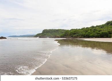 Big open sand beach Montezuma Costa Rica