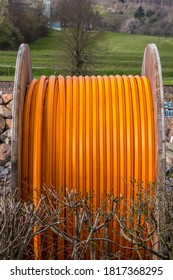 Big orange cable reel outside on the ground