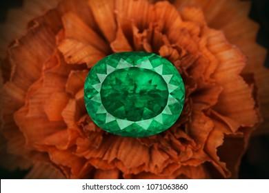 Big oval cut emerald on flower.