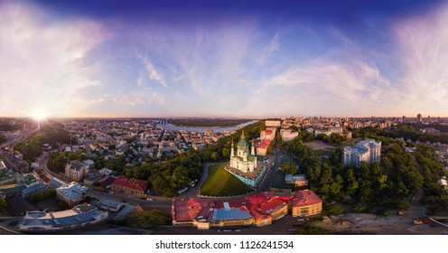 A big panorama of the city of Kiev on Podol at sunset. A modern metropolis in the center of Europe against the backdrop of sunset sky from a bird's eye view. Aerial view. Panorama of the Tourist