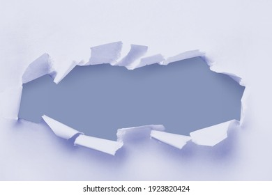 Big paper hole in the center of colored background.