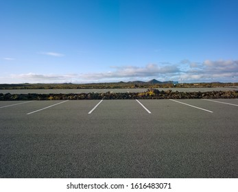 Big parking area with lots of parking spaces in Iceland in a volcanic landscape with rocks and moss. Backplate for automobile industry and cgi.
