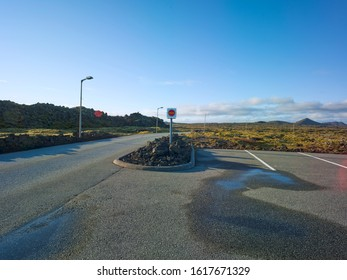 Big parking area with lots of parking spaces in Iceland in a volcanic landscape with rocks and moss. Driveway at one side. Backplate for automobile industry and cgi.