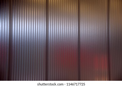 big partition wall with milky and blurry segments, separated area behind a pvc partition