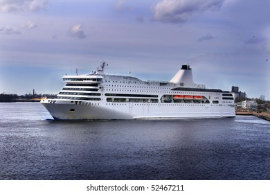 Big passenger cruise ship is departing from port of Riga, Latvia and is going to Baltic Sea.