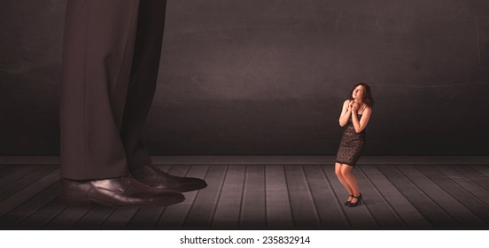 Big person with small businesswoman concept on background