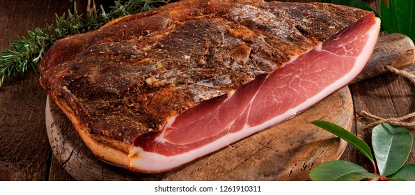A big piece of bacon with spices