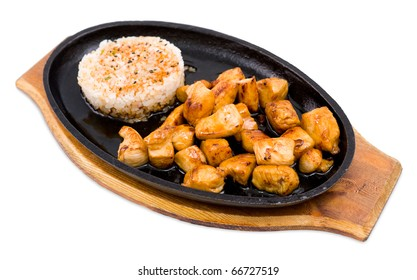 big pieces of grilled chicken, garnished with rice