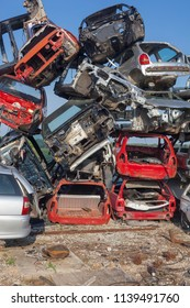Big pil of old cars on junkyard are waiting for recycling