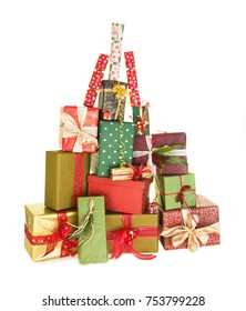 Big pile of christmas presents in the shape of a christmas tree