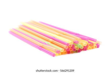 Big pile of colorful plastic drinking straws isolated over the white background