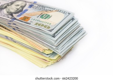 big pile of dollars isolated on white background.