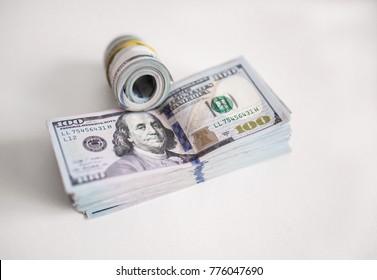 big pile of money. dollars over white background. big pile of dollars