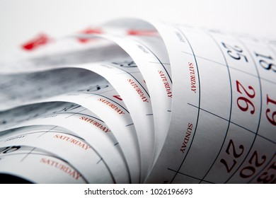 big pile of printed wall calendar sheets closeup