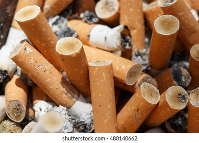 Big pile of put out cigarettes. Smoking, smoker, addiction, health hazard, lung cancer concept.