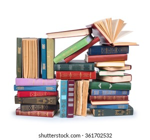big pile of vintage books with open top isolated on white background