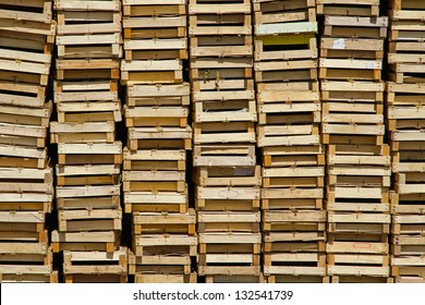 Big pile of wooden crates for fruits