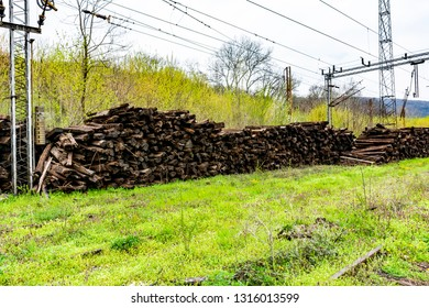 Big piles of old weathered railway wooden sleepers - Out of use wooden sleeper used for railway track