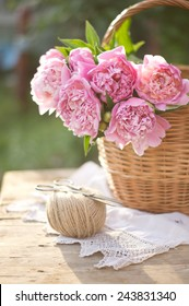 Big pink peonies in a basket on the setting sun shabby ?hic style