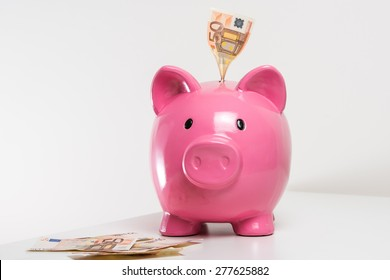 Big pink pig with fifty euro note