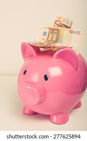 Big pink pig with fifty euro note, vingate edition