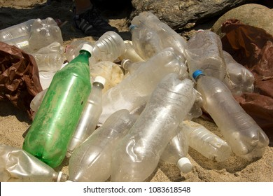 Big plastic pollution, plastic and waste from ocean on the beach environmental issue