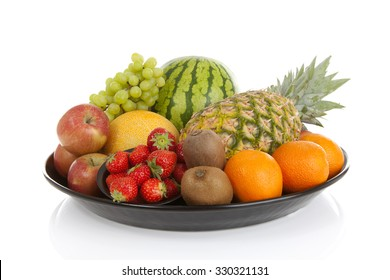 Big plate with lots of healthy fruits over white background