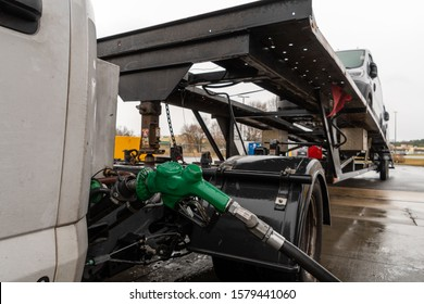 Big Pool, MD / USA Dec 4, 2019 Car hauler filling up diesel tank on trucking gas station. Diesel prices are high while the industry is suffering with low load prices and availability.