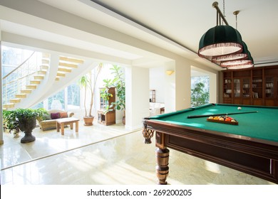 Big pool table in spacious living room