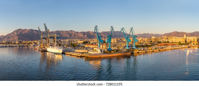 Big port cargo cranes in Palermo, Italy in a beautiful summer day