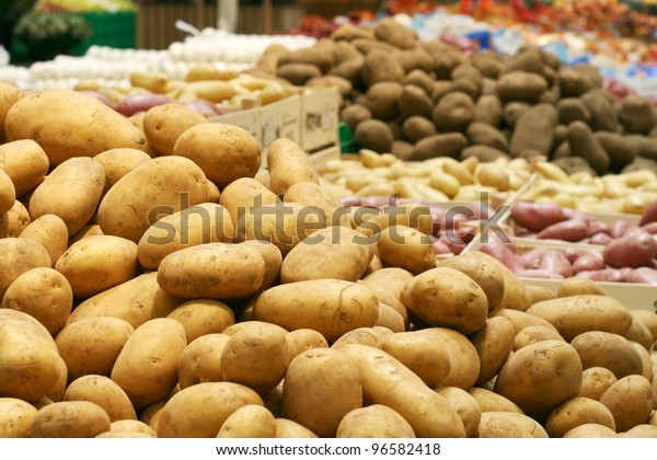 Big potatoes in supermarket stand