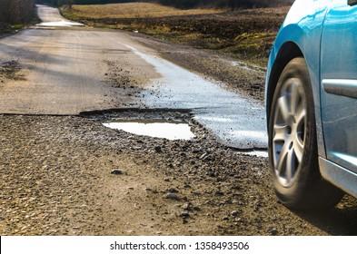 Big pothole on road after winter